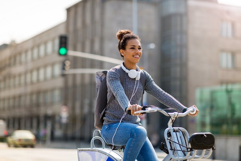 Young lady riding bike in a city